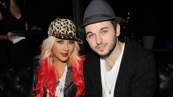 Christina Aguilera (L) and Matt Rutler attend the Samsung Galaxy Note II Beverly Hills Launch Party on October 25, 2012 in Los Angeles, California.