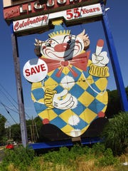"Calico the ""Evil Clown"" was originally built to advertise Joseph Azzolina's Food Circus store, the predecessor to the Foodtown supermarket chain. Calico would be protected according to plans to develop a town center nearby."