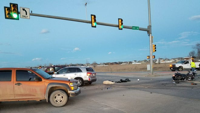 Larimer County Sheriff's Office deputies investigate a crash at U.S. Highway 287 and West County Road 8 (Mountain Avenue) in Berthoud on Tuesday, Jan. 9, 2018.