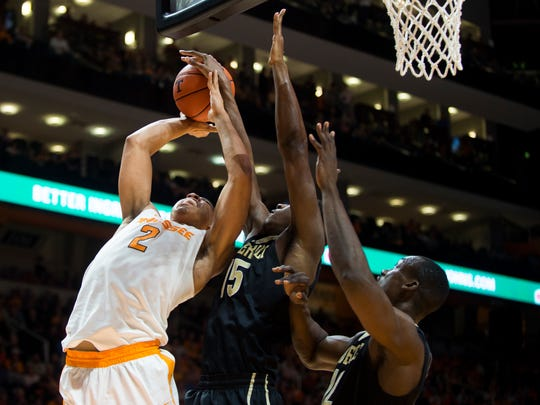 Tennessee's Grant Williams (2) attempts a shot past VanderbiltÕs Clevon Brown (15) and Djery Baptiste (12) during Tennessee's game against Vanderbilt at Thompson-Boling Arena on Wednesday, Feb. 22, 2017. Tennessee lost to Vanderbilt 67-56.