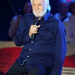 "FILE - In this Sept. 13, 2014, file photo, Kenny Rogers performs in concert during the ""Star-Spangled Spectacular: Bicentennial of Our National Anthem Concert"" in Baltimore. Rogers will be honored this year as the CMT Artist of a Lifetime for his extensive music career spanning across multiple genres for decades. CMT will present the honor to Rogers at the CMT Artists of the Year awards show in Nashville, Tenn. on Dec. 2, 2015."