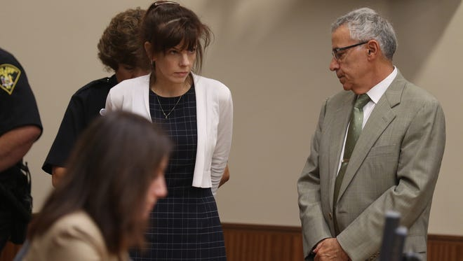 Laura Rideout is handcuffed and lead to jail after the judge spoke to her and her attorneys, including Michael DiPrima, about the verdict and sentencing date.