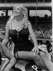 Linda Vaughn, best known as Miss Hurst Golden Shifter, rides in the pre-race parade at the Indy 500 at the Indianapolis Motor SpeedwayMay 27, 1980.