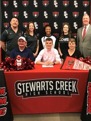 Stewarts Creek's Michael Brewer recently signed with Martin Methodist to cheer. Pictured in the front row (l-r) are Tommy, Michael and Cheryl Brewer. In the back row (l-r) are MMC coaches Micah and Monica Hartsfield, SCHS coaches Alonna Smith and Christine Byrd and SCHS Principal Dr. Clark Harrell