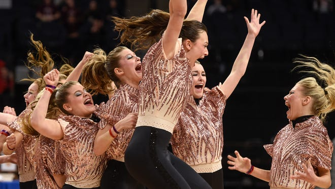 Sartell Dance Team members celebrate their state championship win in Minnesota State Dance Team High Kick competition Saturday, Feb. 17, at the Target Center in Minneapolis.