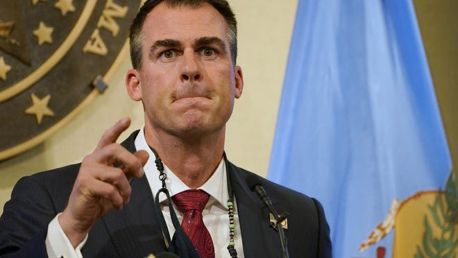 Oklahoma Gov. Kevin Stitt speaks during a news conference in Oklahoma City, Monday, Nov. 16, 2020. Stitt is imposing new restrictions on bars and restaurants and requiring masks in state buildings as officials attempt to control the surging number of coronavirus infections.