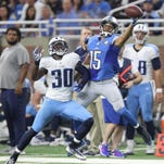 Detroit Lions Golden Tate drops a pass as the Tennessee Titans Jason McCourty defends during fourth quarter action Sunday, September 18, 2016 at Ford Field Detroit MI.