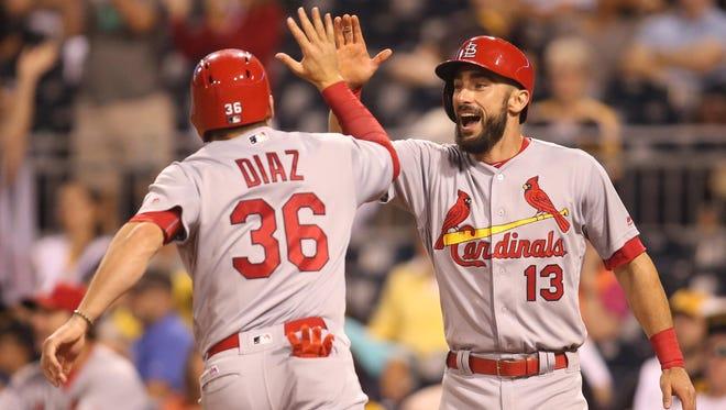 St. Louis Cardinals' Aledmys Diaz and Matt Carpenter (13) celebrate after scoring during the twelfth inning Friday.