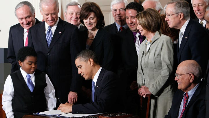 President Obama signs the Affordable Care Act during