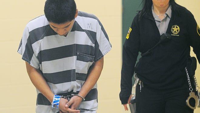 Mario Alberto Banegas-Jaen is escorted Friday in the Minnehaha County Courthouse.