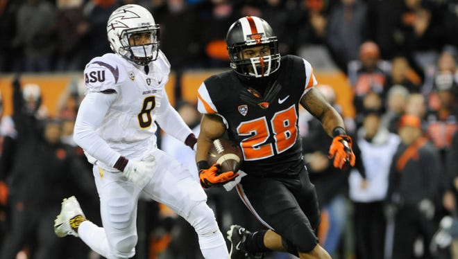 Oregon State running back Terron Ward runs past Arizona State defensive back Lloyd Carrington (8) for a 66-yard touchdown in the first quarter on Saturday, Nov. 15, 2014.