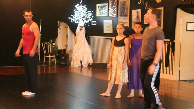"""Justin Sherwood, far right, coaches Brit Burns, far left, Valerie Thomas and Gracie Aguilar for """"The Nutcracker"""" which debuts in December."""