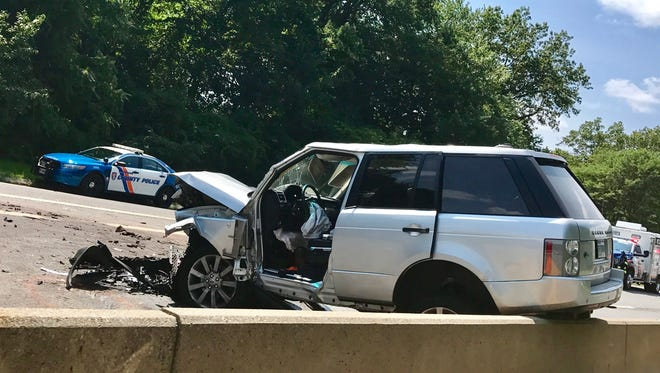 A vehicle partially lays on the divider after an accident on the northbound Hutchinson River Parkway, Aug. 20, 2017.