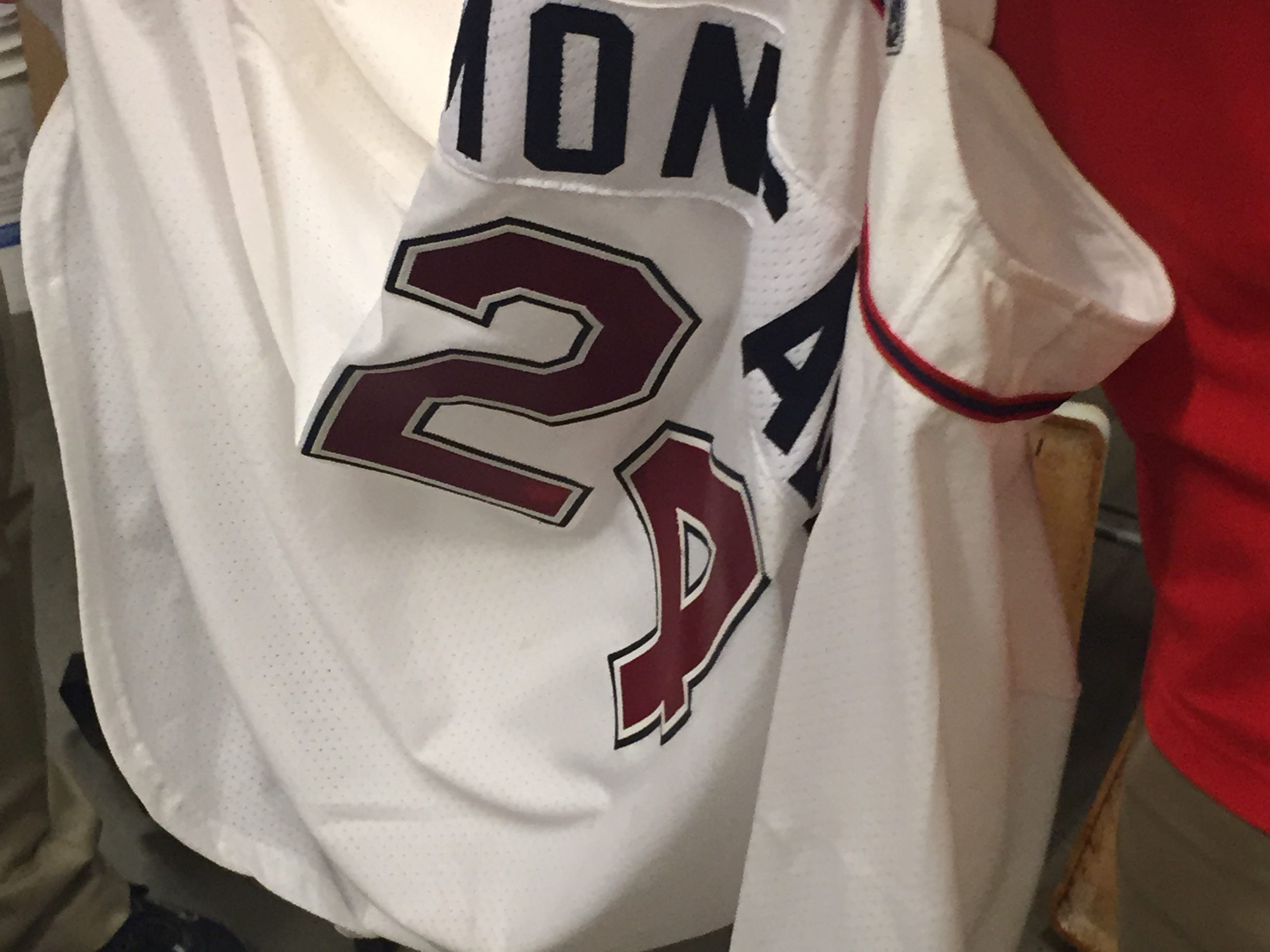 A MLB authenticator inspects the jersey Yoan Moncada wore for his first game with the Greenville Drive on May 18, 2015.