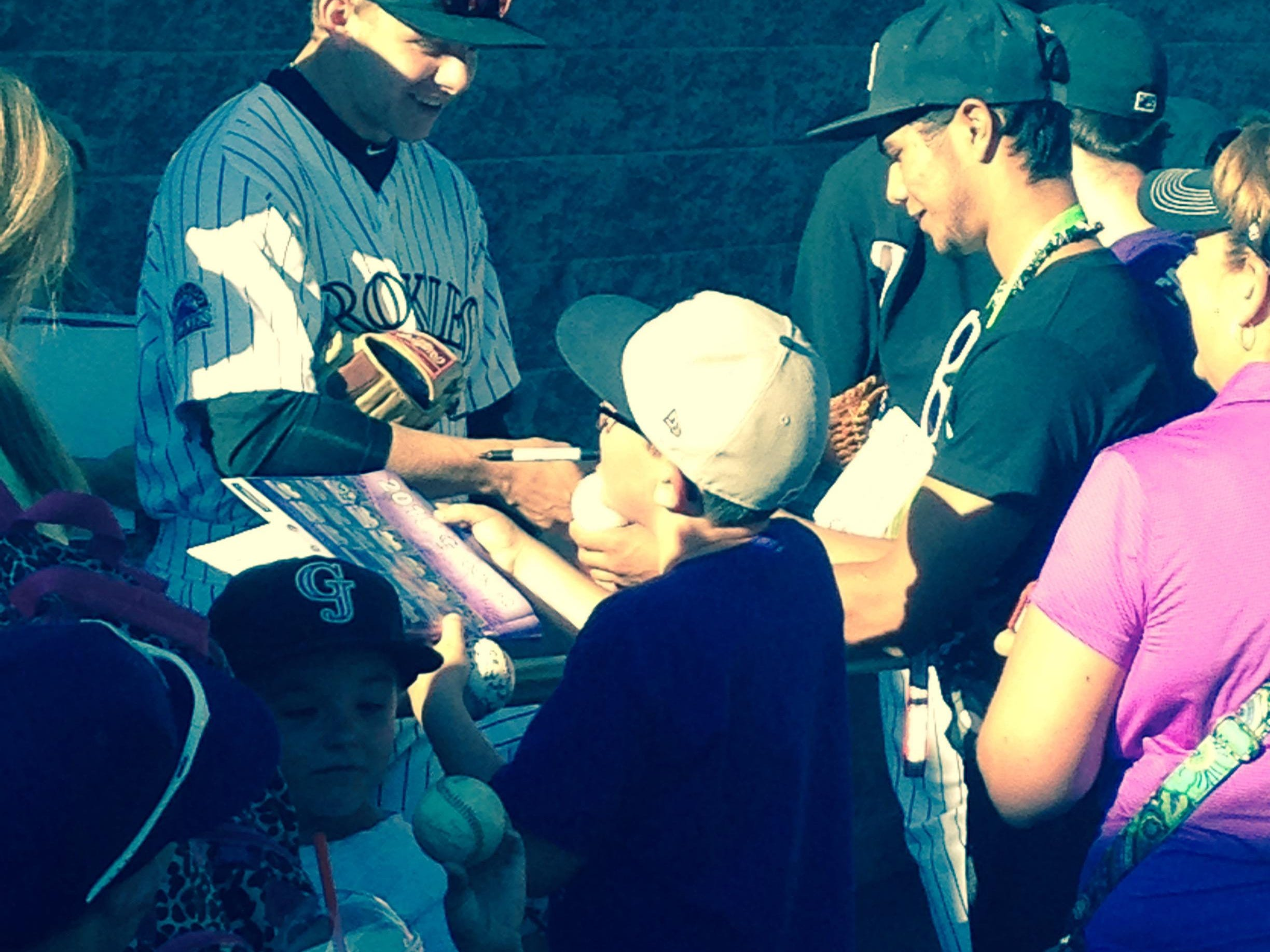 Rocky Mountain High School graduate Cole Anderson signs autographs before playing in the home opener for the Grand Junction Rockies, the rookie league affiliate of the Colorado Rockies.