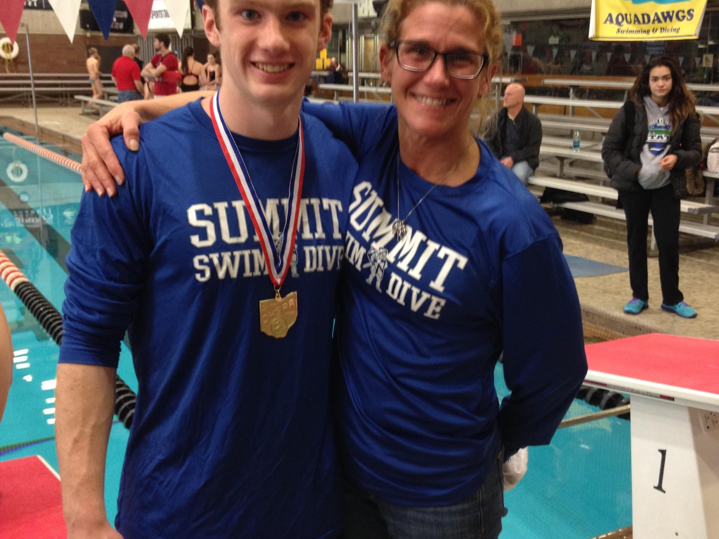Summit Country Day's newest state champion Stewart Spanbauer celebrates with his diving coach Lori Rapp after winning the the 2015 1-meter diving title. Rapp was recently inducted into the LaRosa's High School Sports Hall of Fame for her diving and coaching accomplishments.