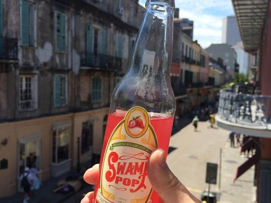 When April Courville got an itch for a good stout or glass of wine, she'd turn to other tasty beverages like hot chocolate, flavored sparkling water or a specialty soda like Swamp Pop. Shown is Swamp Pop's seasonal Ponchatoula pop rouge