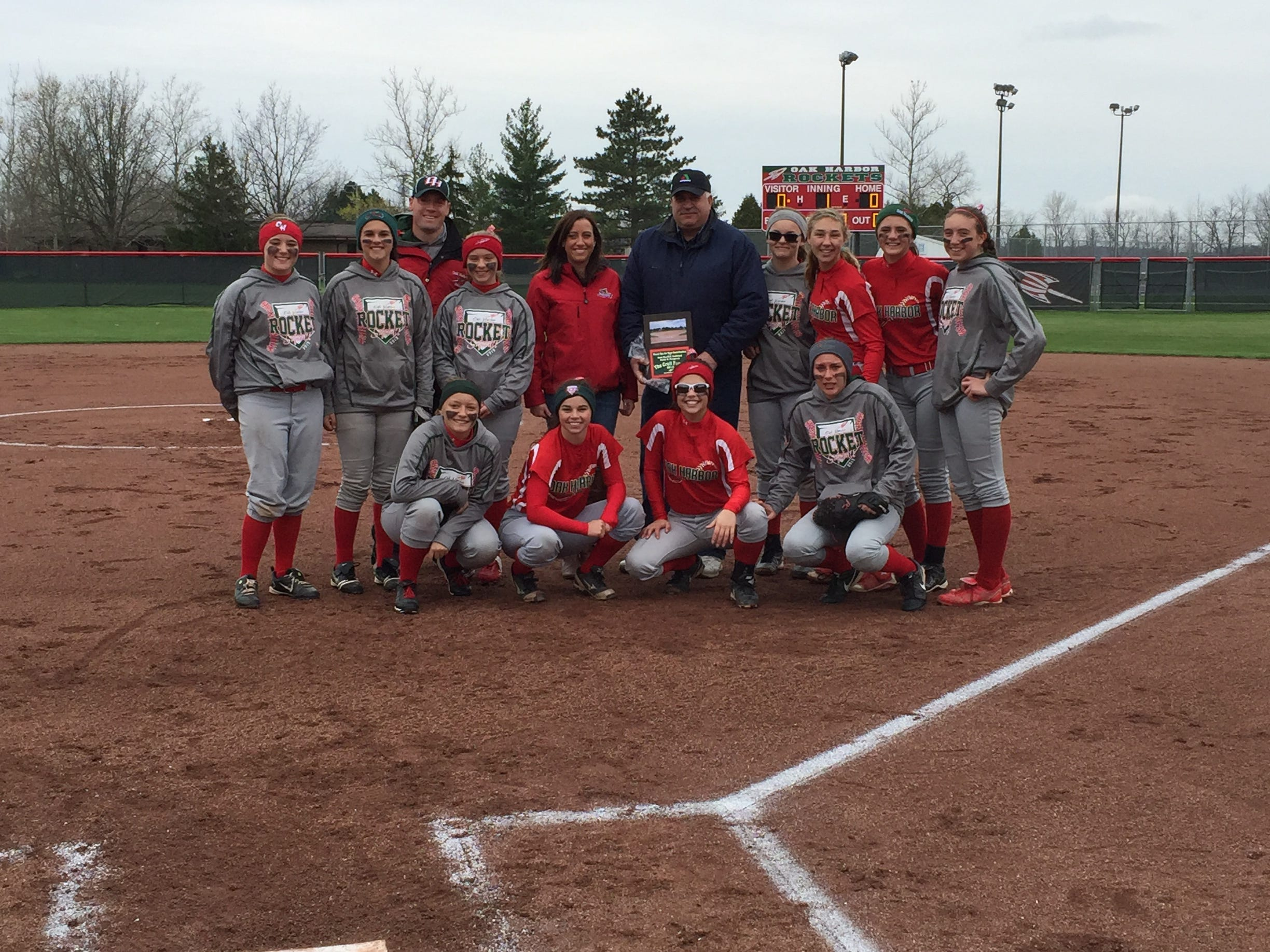 Oak Harbor's softball team with E.J. Croll (pictured at center).