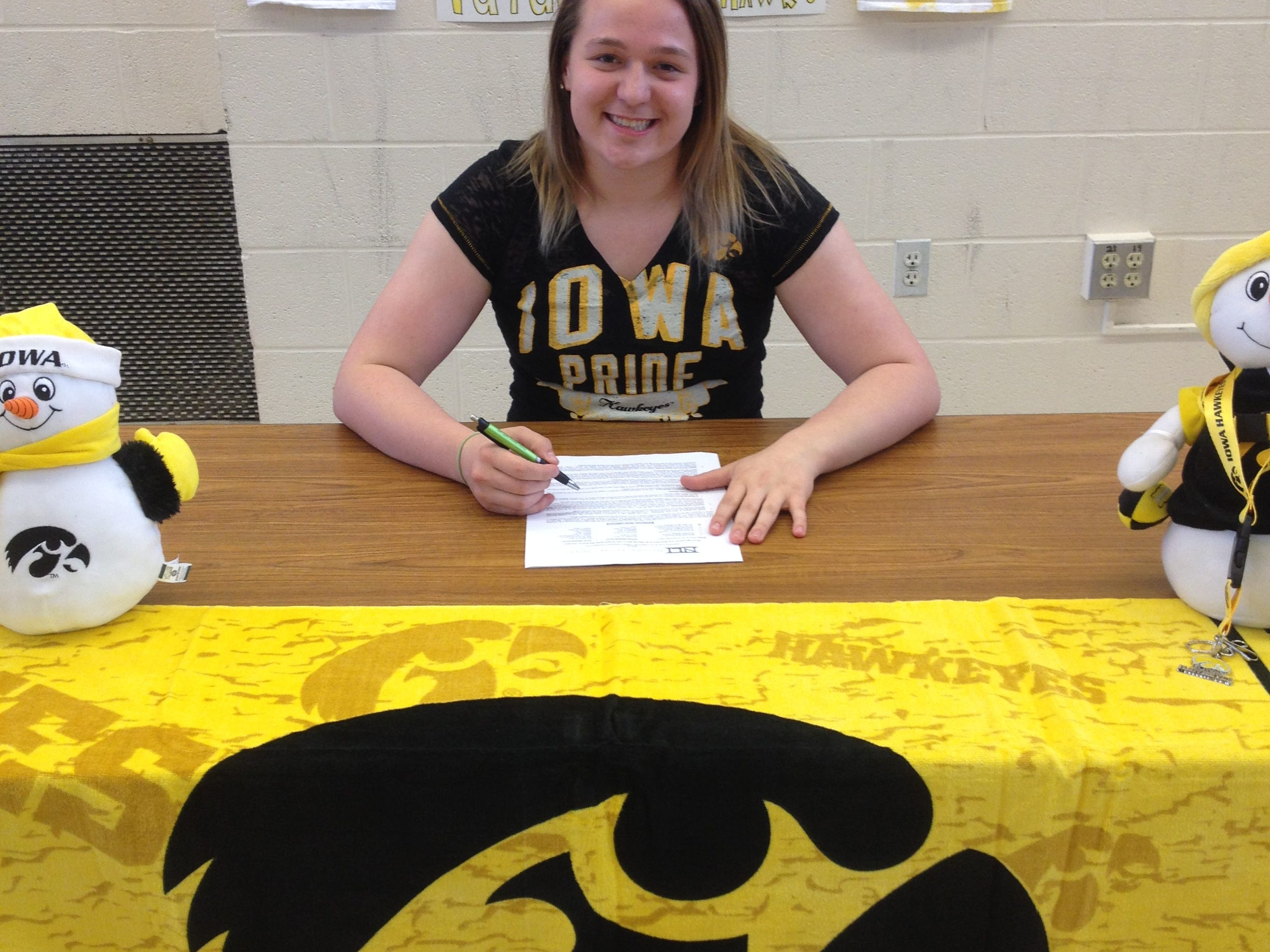 West High senior diver Jacintha Thomas signed a National Letter of Intent with Iowa on Wednesday. Thomas broke a state meet record with 561.10 total points last November.