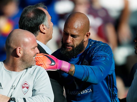 FILE--In this Nov. 6, 2016, file photo, Los Angeles Galaxy head coach Bruce Arena, left, congratulates Colorado Rapids goalkeeper Tim Howard after Howard stopped shots in the second-leg soccer match of the Western Conference semifinals of the MLS cup playoffs in Commerce City, Colo. Arena discussed his roster on Monday, May 29, 2017, as players gather to train for a World Cup qualifying match against Trinidad and Tobago on June 8 in Commerce City. (AP Photo/David Zalubowski, File)