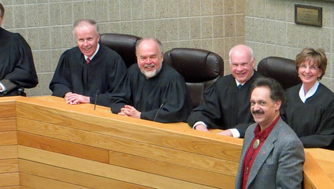 John Glover, right, stands with South Dakota Supreme Court justices