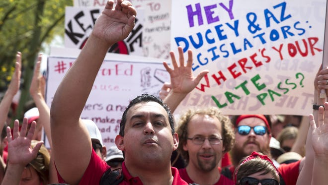 Supporters cheer during a rally, April 30, 2018, at the Arizona Capitol in Phoenix on the third day of the Arizona teacher walkout.