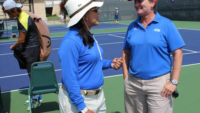 Stephanie Burnam, right, talks with another USTA roving umpire, Eliza Cotner of Dallas, after Burnam watched the end of a match won by Nico Dominguez of Dallas, left.