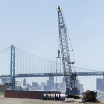 The Detroit skyline and Ambassador Bridge can be seen from the Detroit/Wayne County Port Authority facility on Tuesday.
