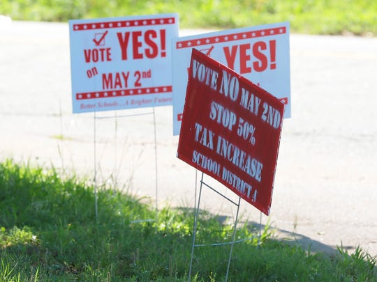 Signs about the Anderson School District 4 bond referendum in front of Pendleton Elementary School on Tuesday.