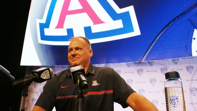 Arizona head coach Rich Rodriguez talks with reporters at the Pac-12 NCAA college football media day in Los Angeles Thursday, July 14, 2016.