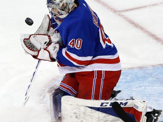 New York Rangers goaltender Alexandar Georgiev (40), of Bulgaria, makes a save during the second period of an NHL hockey game against the Carolina Hurricanes in New York, Monday, March 12, 2018. (AP Photo/Kathy Willens)