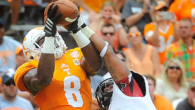 Tennessee wide receiver Marquez North (8) pulls in a touchdown pass as the University of Tennessee plays Arkansas State at Neyland Stadium.  Saturday Sept. 6, 2014, in Knoxville, TN.