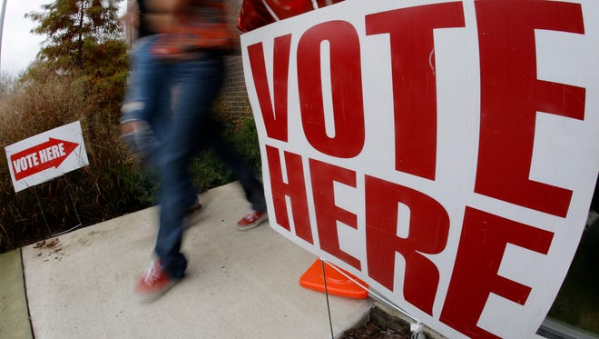 Voters leave a polling place on Election Day in Nashville on Nov. 6, 2012.