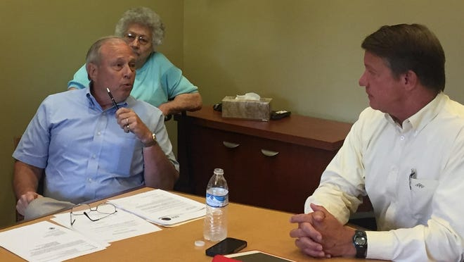 Campbell County Commissioner speaks with Judge-executive Steve Pendery about delaying appointing Chuck Heilman to a new term on Sanitation District No. 1 of Northern Kentucky's board of directors.