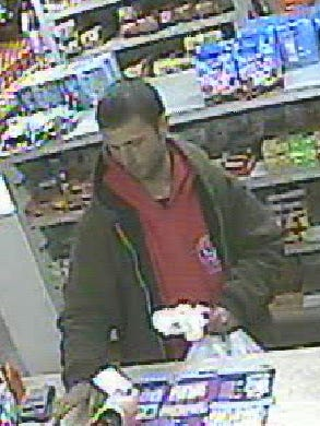 The Evansville Police Department released photos Wednesday, Jan. 18, 2017 of a man accused of using a stolen credit card at a convenience store on Nov. 26, 2016.