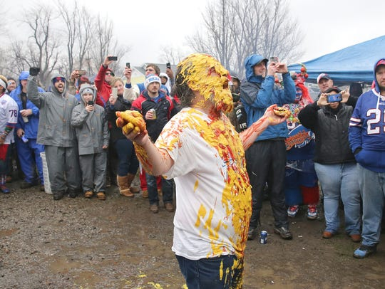 Ken Johnson of Rochester is squirted with mustard and