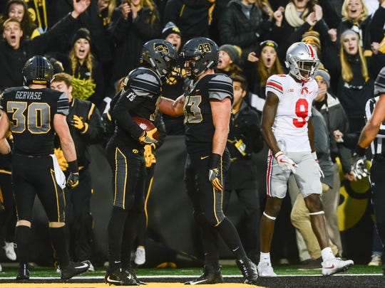 Nov 4, 2017; Iowa City, IA, USA; Iowa Hawkeyes defensive back Joshua Jackson (left) and linebacker Josey Jewell (right) celebrate in interception by Jackson during the game against the Ohio State Buckeyes at Kinnick Stadium. Iowa won 55-24. Mandatory Credit: Jeffrey Becker-USA TODAY Sports