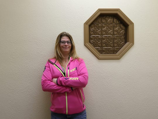 Chanda Hardwick, manager of Tactical Escape 101 in Stevens Point, poses inside the maze of large and tiny rooms part of the business, Dec. 8, 2016.