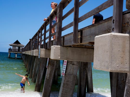 Roberto Martinez, 9, tries out his goggles underneath the Naples Pier Friday, June 23, 2017. A health advisory warning was lifted Friday afternoon by the Florida Department of Health in Collier County for the water surrounding the Naples Pier. A roughly four-block section of the beach had been placed on the health warning since Monday of this week due to high levels of bacteria most likely caused by high levels of rainfall and runoff.