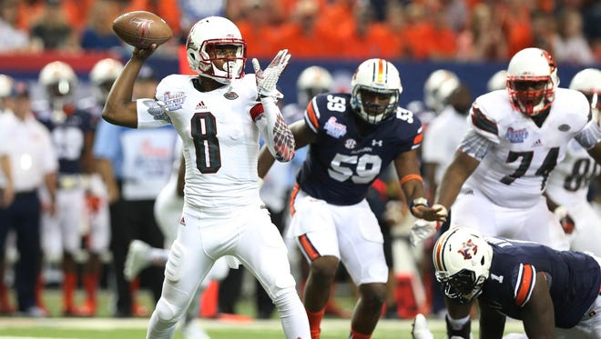 Sep 5, 2015; Atlanta, GA, USA; Louisville Cardinals quarterback Lamar Jackson (8) throws the ball pressured by Auburn Tigers defensive lineman Raashed Kennion (59) during the third quarter in the 2015 Chick-fil-A Kickoff Game at the Georgia Dome. Mandatory Credit: Jason Getz-USA TODAY Sports