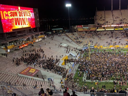 ASU fans storm the field and celebrate with the players