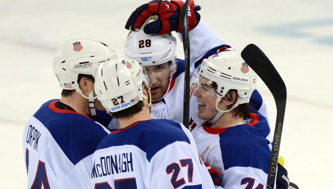 USA defenseman Ryan McDonagh (27) is congratulated by teammates after scoring a goal against Slovenia.
