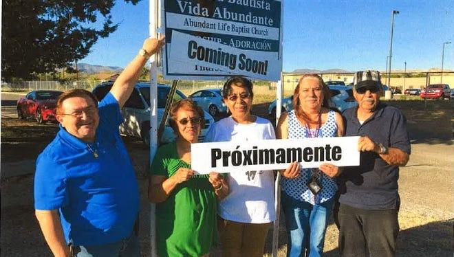 Pastor Pedro and other members of the Iglesia Bautista Vida Abundante Church in Santa Clara with the church's new sign