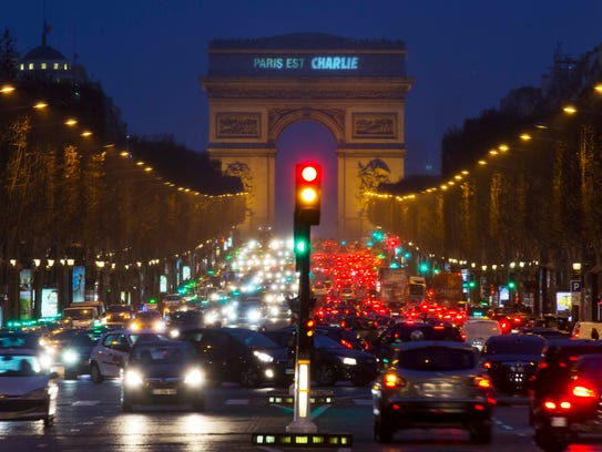 "A sign on the Arc de Triomphe reads ""Paris is Charlie"""