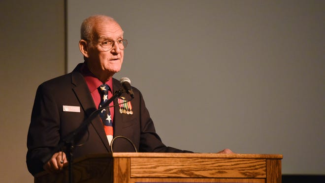 Retired Navy Capt. Bill Kennedy, director of the Navy-Marine Corps Relief Society, speaks at the Franklin D. Roosevelt Presidential Library and Museum.