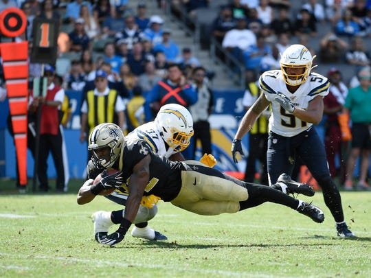 CARSON, CA - AUGUST 18: Devine Ozigbo #32 of the New Orleans Saints dives after a rushing against Kemon Hall #37 of the Los Angeles Chargers during the second half of their pre season football game at Dignity Health Sports Park on August 18, 2019 in Carson, California. (Photo by Kevork Djansezian/Getty Images)