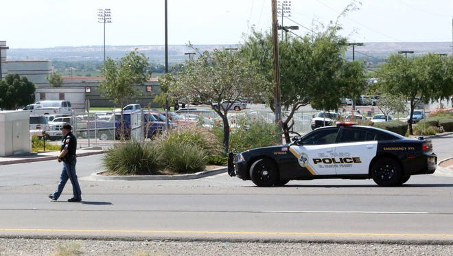 An El Paso police car blocks a road that runs between the El Paso Community College Northwest campus and Canutillo High School during and alleged incident there Friday afternoon.