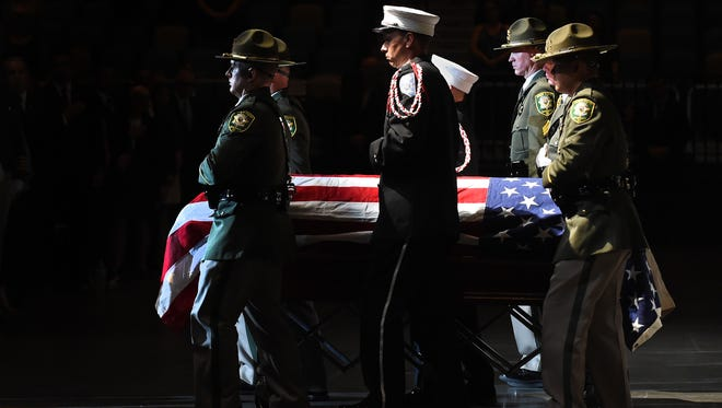 The color guard rolls Deputy Sheriff Carl Howell's casket out after the memorial service at the Reno Events Center on Aug. 20. Carson City businesses will host an event on Oct. 10 to benefit his family.