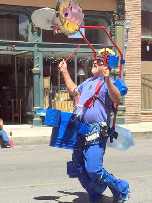 Jerry Boswell Blue Can Man won the Walking Group Division of the Silver City Independence Day Celebration Parade.