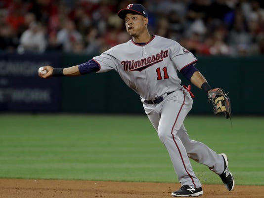 Minnesota Twins shortstop Jorge Polanco throws out Los Angeles Angels' Andrelton Simmons at first during the sixth inning of a baseball game in Anaheim, Calif., Thursday, June 1, 2017. (AP Photo/Chris Carlson)